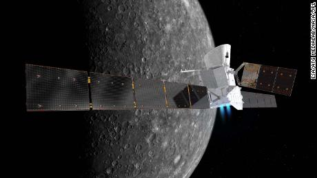 Artist's impression of the BepiColombo spacecraft in cruise configuration, with Mercury in the background. On its 7.2 year journey to the innermost planet, BepiColombo will fly by Earth once, Venus twice and Mercury six times before entering into orbit. The Mercury Transfer Module is shown with ion thrusters firing, and with its solar wings extended, spanning about 30 m from tip-to-tip. The 7.5 m-long solar array of the Mercury Planetary Orbiter in the middle is seen extending to the top. The Mercury Magnetospheric Orbiter is hidden inside the sunshield in this orientation.  BepiColombo is a joint endeavour between ESA and the Japan Aerospace Exploration Agency, JAXA.  The view of Mercury is based on imagery from NASA's Mariner 10 mission.
