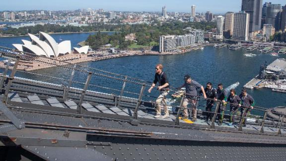 Harry, Australian Prime Minister Scott Morrison and Invictus Games representatives climb the Sydney Harbour Bridge in Sydney.