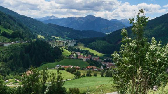 View of the mountains of South Tyrol next to the motorway bridge of the Brenner Highway.