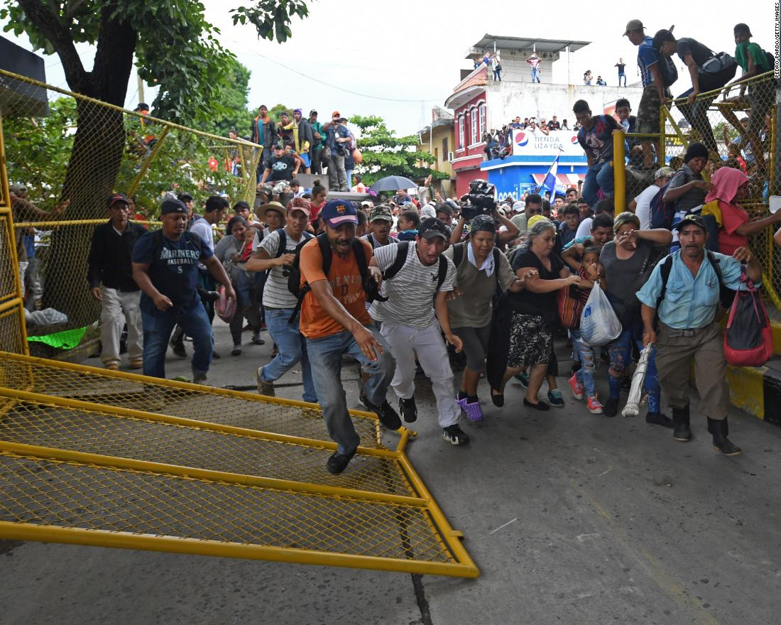 94ed125184 Honduran migrants heading in a caravan to the United States rush through  the Guatemala-Mexico