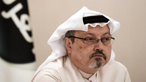 "A general manager of Alarab TV, Jamal Khashoggi, looks on during a press conference in the Bahraini capital Manama, on December 15, 2014. The  pan-Arab satellite news broadcaster owned by billionaire Saudi businessman Alwaleed bin Talal will go on air February 1, promising to ""break the mould"" in a crowded field."