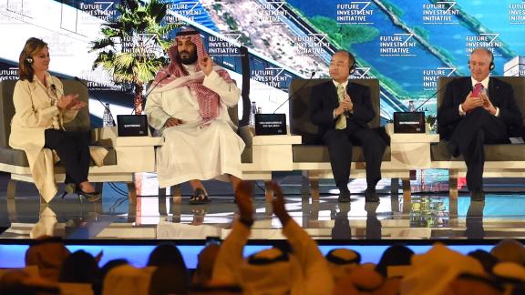 """Saudi Crown Prince Mohammed bin Salman (2ND L), US journalist Maria Bartiromo (L), Masayoshi Son (3RD l), the Chief Executive Officer of SoftBank and Stephen Shwarzman, CEO of the Blackstone Group, attend the Future Investment Initiative (FII) conference in Riyadh, on October 24, 2017. The Crown Prince pledged a """"moderate, open"""" Saudi Arabia, breaking with ultra-conservative clerics in favour of an image catering to foreign investors and Saudi youth.  """"We are returning to what we were before -- a country of moderate Islam that is open to all religions and to the world,"""" he said at the economic forum in Riyadh."""