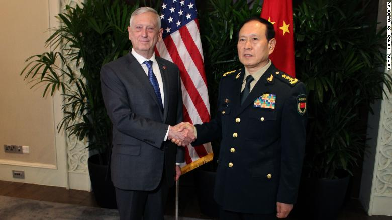 US Defence Secretary Jim Mattis shakes hands with his Chinese counterpart General Wei Fenghe in Singapore on October 18.