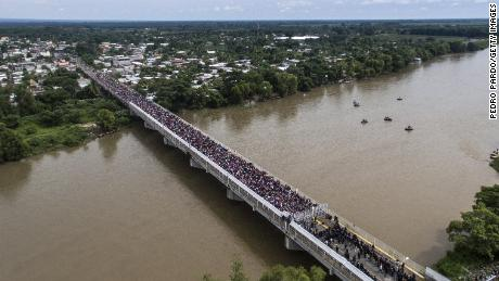 An aerial view shows the walking caravan waiting for the international bridge Guatemala Mexico in Ciudad Hidalgo, Chiapas state, Mexico.