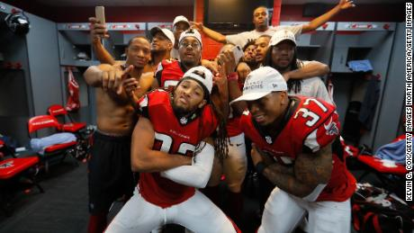 ATLANTA, GA - JANUARY 22: Jalen Collins #32 and Ricardo Allen #37 of the Atlanta Falcons celebrate with teammates in the locker room after defeating the Green Bay Packers in the NFC Championship Game at the Georgia Dome on January 22, 2017 in Atlanta, Georgia. The Falcons defeated the Packers 44-21. (Photo by Kevin C. Cox/Getty Images)