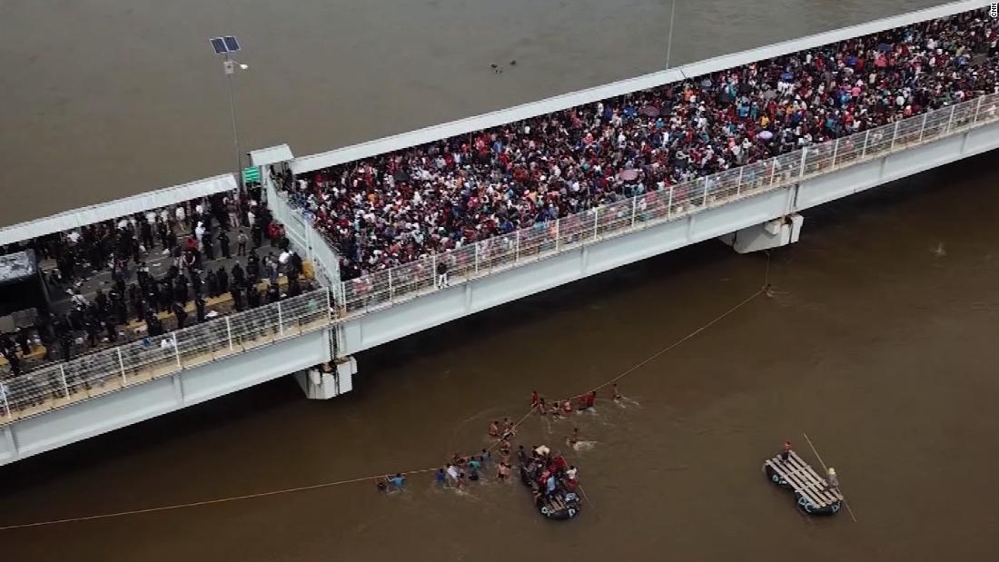 Thousands of migrants try to cross into Mexico