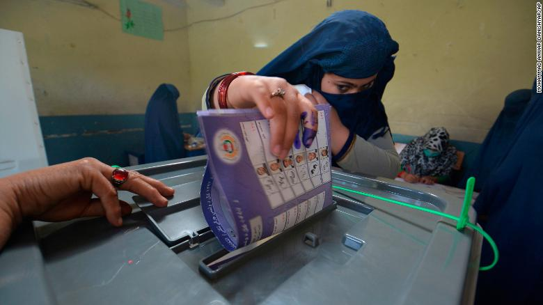 A woman casts her vote at a polling station in Jalalabad, the capital of Afghanistan's eastern Nangarhar province.