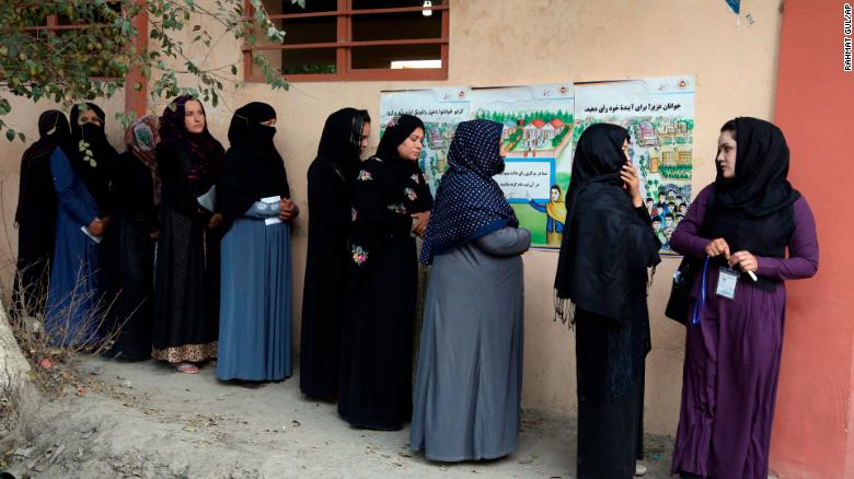 Afghan women line up to cast their votes Saturday outside a polling station in Kabul.