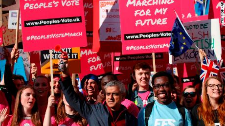 London Mayor Sadiq Khan, front center, holds a klaxon horn as he joins protesters in the People's Vote March for the Future on Saturday.