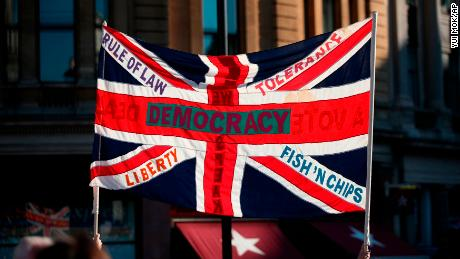 A British Union flag is held aloft during the march through London on Saturday.