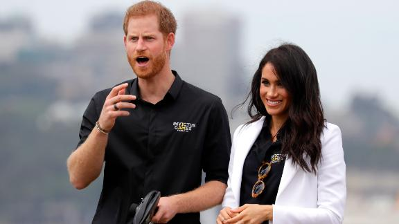 Meghan, Duchess of Sussex, watches as Prince Harry operates a remote-control car at the Invictus Games driving challenge on Saturday, on Cockatoo Island in Sydney.
