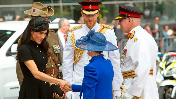 Harry and Meghan speak with Governor of New South Wales David Hurley and his wife, Linda Hurley, before attending the opening of the enhanced ANZAC Memorial in Sydney.