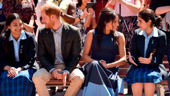 Harry and Meghan watch a performance during their visit on Friday, October 19, to Macarthur Girls High School near Sydney.