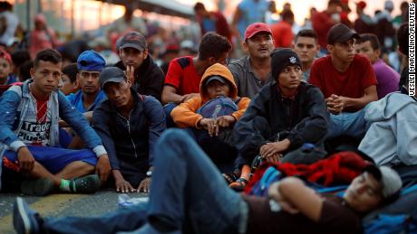 Honduras immigrants are waiting for a port on a bridge connecting Mexico and Guatemala in Ciudad Hidalgo, Mexico.