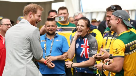 Prince Harry meets Australian athlete Ben Yeomans during the Invictus Games Cycling at the Royal Botanical Gardens on Sunday in Sydney.