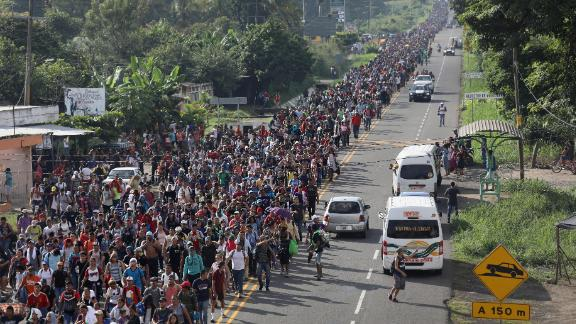 A migrant caravan headed to the United States walks into Mexico after crossing the Guatemalan border on Sunday, October 21.