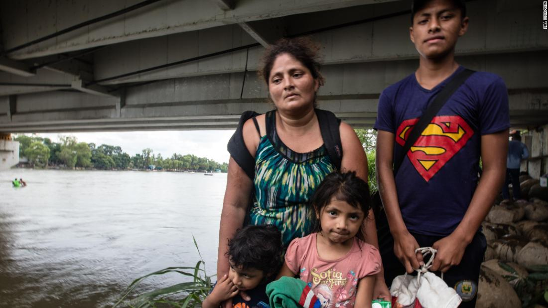 The Guillermo family pose for a photo, moments after reaching Mexico. Rosalin stands with her son Miner, 16, three-year-old Carlitos and Candy, 5.