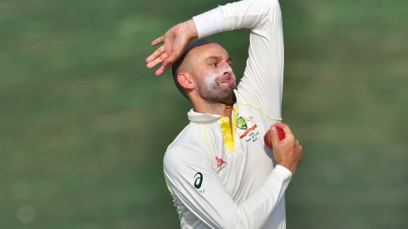 This man is about to bowl a cricket ball really, really hard.