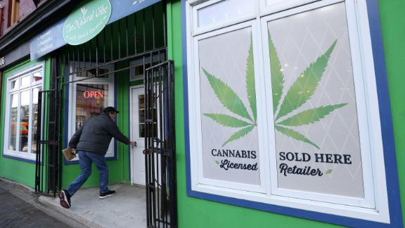 A customer enters the Natural Vibe store after legal recreational marijuana went on sale in St John's, Newfoundland and Labrador, Canada October 17, 2018. REUTERS/Chris Wattie