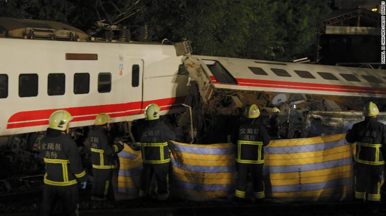 Rescue workers attend the scene after the Puyuma Express train derailed near Xima station in Taiwan's northeastern Yilan county on October 21, 2018.