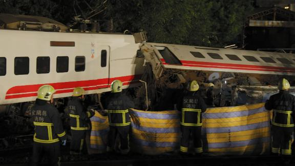 Rescue workers attend the scene after the Puyuma Express train derailed near Xima station in Taiwan