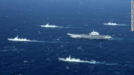 This aerial photo taken on January 2, 2017 shows a Chinese navy formation, including the aircraft carrier Liaoning (C), during military drills in the South China Sea. The aircraft carrier is one of the latest steps in the years-long build-up of China's military, as Beijing seeks greater global power to match its economic might and asserts itself more aggressively in its own backyard.  / AFP / STR / China OUT        (Photo credit should read STR/AFP/Getty Images)