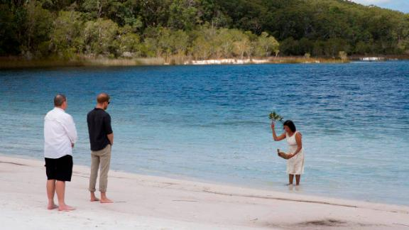 Prince Harry takes part in an aboriginal cleansing ceremony at Lake McKenzie on Fraser Island.