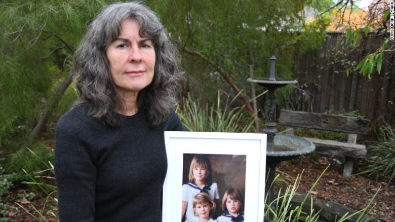 Advocate Chrissie Foster at home in Oakleigh, Melbourne, Australia in May. She's holding a picture of her three daughters Katie, Emma and Aimee. Katie and Emma were both abused by a local Catholic school priest.