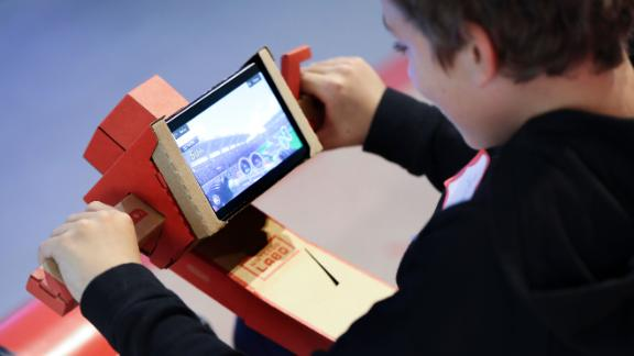 A child tests out the Nintendo Labo kit