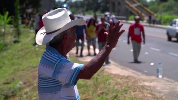 Miguel Hernandez waved as he watched the migrant caravan pass by in the southern Mexican state of Chiapas.