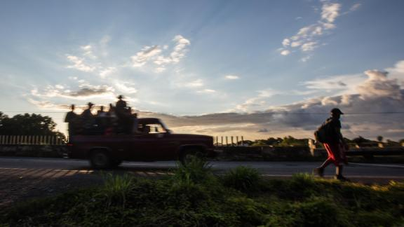 A man walks along the road as the caravan of migrants leaves Tapachula in southern Mexico.