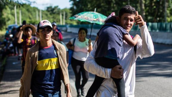 A man gives a thumbs-up sign as migrants leave Tapachula, heading north.