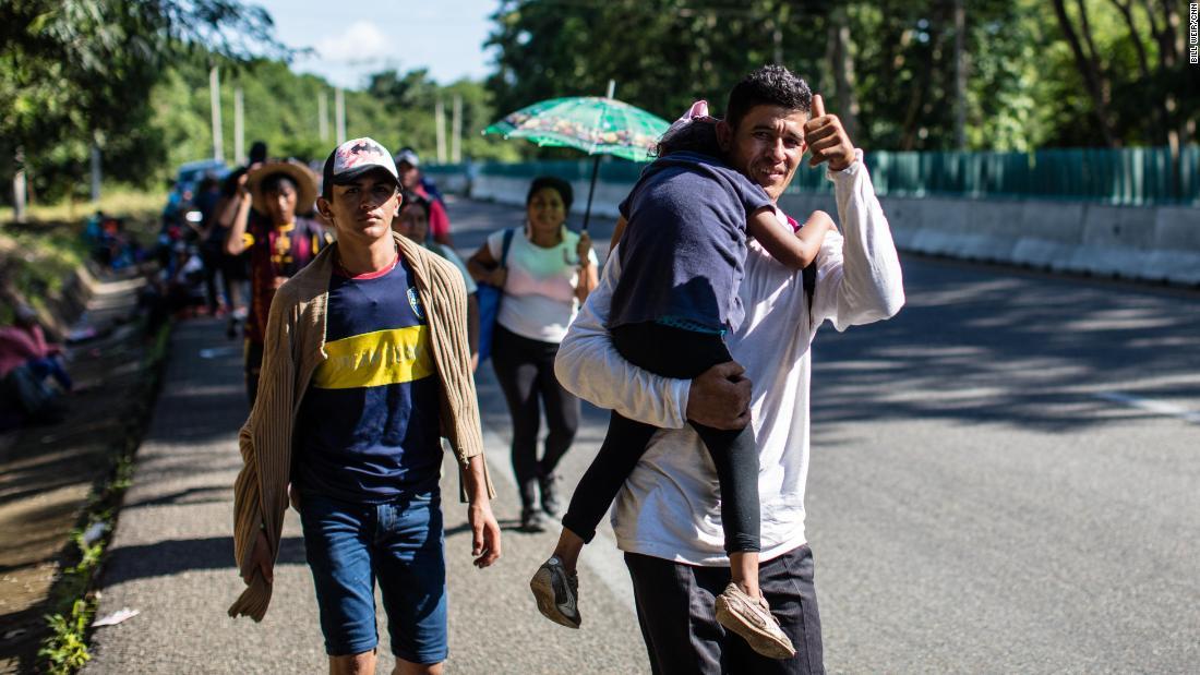 Migrants wake, walk and reject Trump's attacks