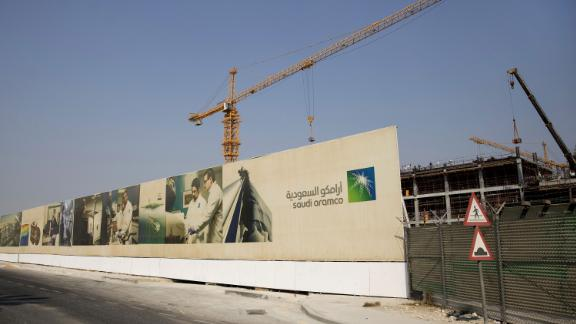Cranes operate at the construction site of a new building project at the Saudi Aramco compound in Dhahran, Saudi Arabia.