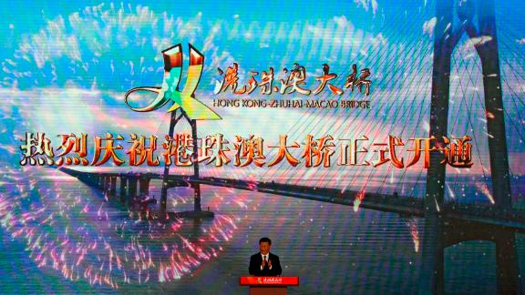 Chinese President Xi Jinping applauds on stage after official opening of the China-Zhuhai-Macau-Hong Kong Bridge, October 23, 2018.