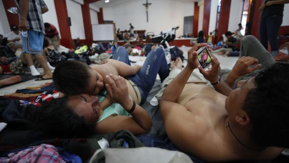 Migrants rest in the town of Huixtla, Mexico.