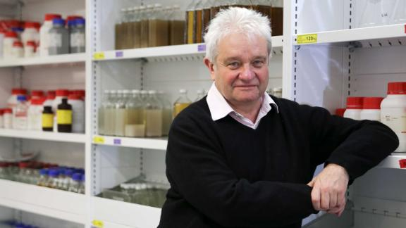 Nobel-winning director Paul Nurse poses for a photograph inside one of his labs inside the new Francis Crick Institute building in London on September 1, 2016.