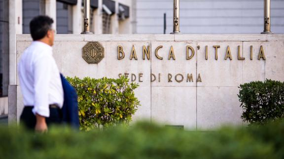 A pedestrian passes Banca d'Italia, Italy's central bank.