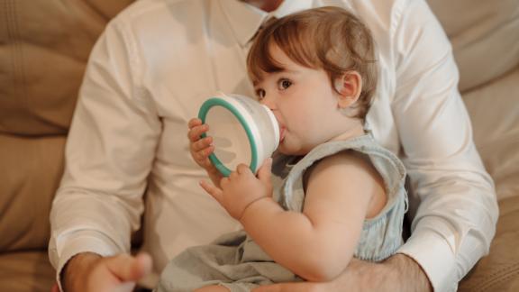 Ayal Lanternari shows how the Nanobebe works by feeding his 1-year-old daughter, Maya, formula at a friend's house in Charleston, South Carolina.