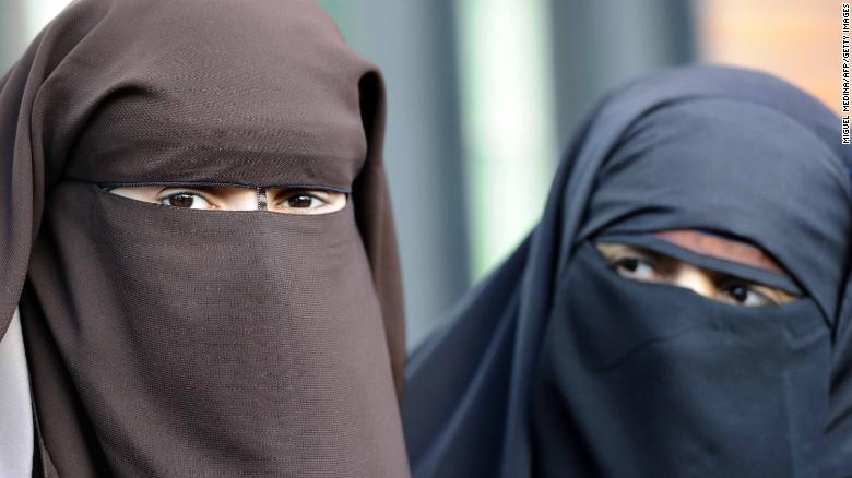 Kenza Drider (right) ran in the 2012 French presidential election after being fined for violating the ban. She has been a high-profile critic of the country's stance on the niqab.