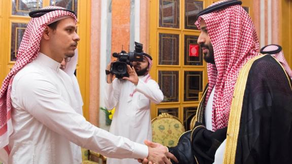 Saudi Crown Prince Mohammed bin Salman and his father King Salman pictured shaking hands with Salah bin Jamal Khashoggi, the journalist's eldest son, and Sahl bin Ahmad Khashoggi, another relative, at Al Yamama Palace in Riyadh in October, after Jamal Khashoggi's killing.