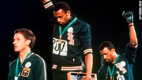 Peter Norman was vilified after he stood with Tommie Smith, center, and John Carlos at the 1968 Olympics.