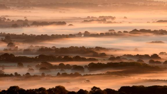 Amberley, United Kingdom: An enchanting mist fills lower-lying areas in South Downs National Park, which is in West Sussex near Amberly, England, in early October.