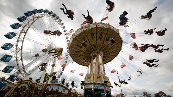 Stuttgart, Germany: Revelers ride a chain carousel at the 173rd Cannstatter Volksfest, a three-week long beer festival and fair. Stuttgart is in southwestern Germany, about a two-hour drive from the French border.