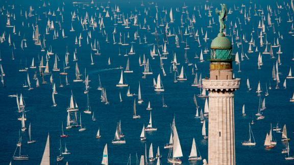 Trieste, Italy: At the 50th Barcolana regatta in Trieste, Italy, boats sail past the Victory Lighthouse. This historic regatta is held annually on the second Sunday of October.