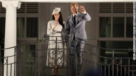 The royal couple waving from the balcony of the Grand Pacific Hotel in Suva.