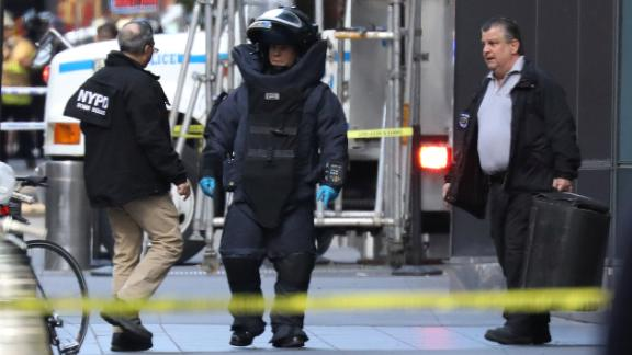 A member of the New York Police Department bomb squad is pictured outside the Time Warner Center in the Manahattan borough of New York City after a suspicious package was found inside the CNN Headquarters in New York, U.S., October 24, 2018. REUTERS/Kevin Coombs