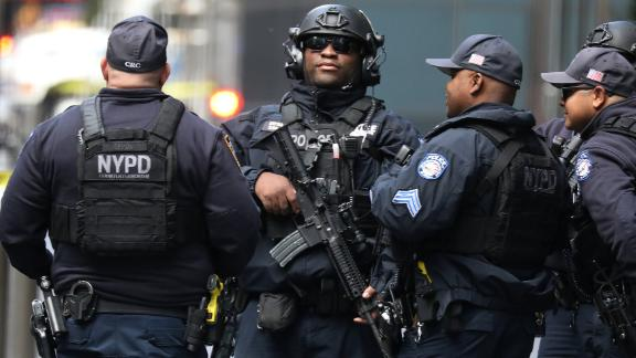 Members of the New York Police Department Counter Terroism Squad are pictured outside the Time Warner Center in the Manahattan borough of New York City after a suspicious package was found inside the CNN Headquarters in New York.