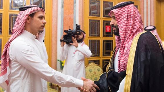 Saudi Crown Prince Mohammed bin Salman and his father King Salman pictured shaking hands with Salah bin Jamal Khashoggi, the journalist
