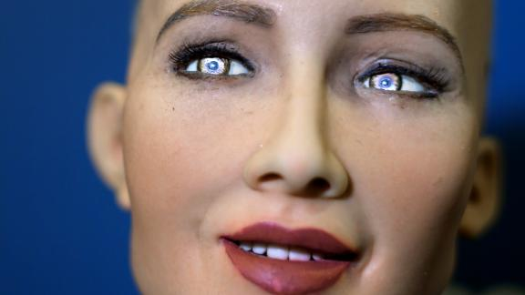 """""""Sophia"""" an artificially intelligent (AI) human-like robot developed by Hong Kong-based humanoid robotics company Hanson Robotics is pictured during the """"AI for Good"""" Global Summit hosted at the International Telecommunication Union (ITU) on June 7, 2017, in Geneva. The meeting aim to provide a neutral platform for government officials, UN agencies, NGO's, industry leaders, and AI experts to discuss the ethical, technical, societal and policy issues related to AI.   / AFP PHOTO / Fabrice COFFRINI        (Photo credit should read FABRICE COFFRINI/AFP/Getty Images)"""